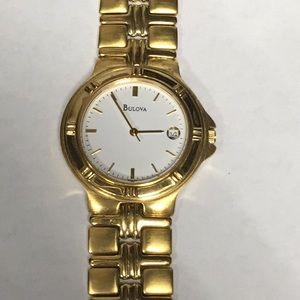 Gold tone with white face Bulova watch